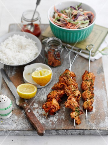 Peri-peri chicken kebabs with rice and colourful coleslaw