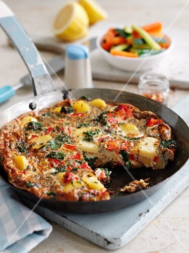 Potato tortilla with spinach and red peppers