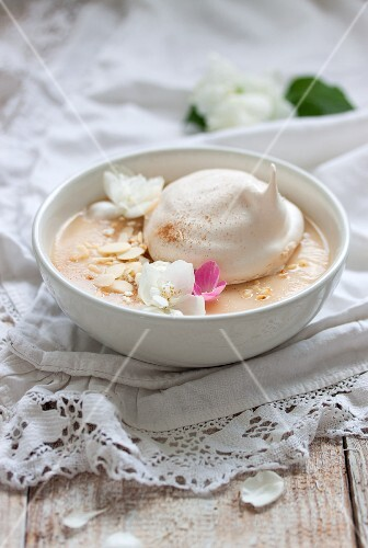 Estonian apple soup with meringue, cream and almonds