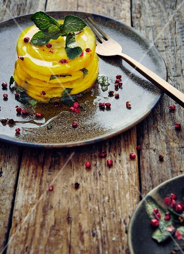 Sliced golden beet with dressing, mint and pink pepper