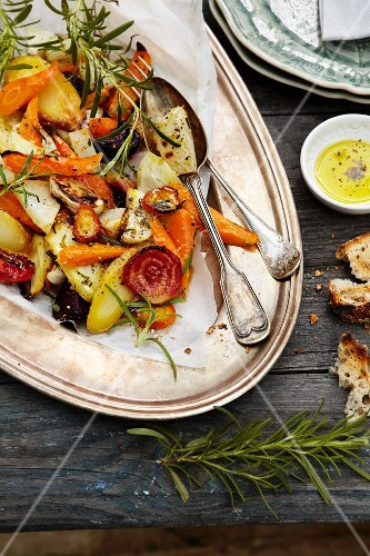 Oven-roasted vegetables with rosemary on a silver platter