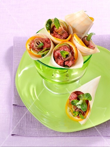 Tatare wraps with blood orange and anchovies