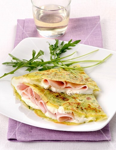 Crespella con rucola, prosciutto e crescenza (rocket pancakes with ham and cheese, Italy)