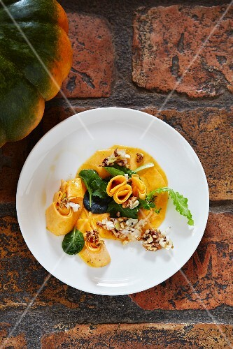 Raw marinated Muscade de Provence squash with macadamia nut oil and walnuts