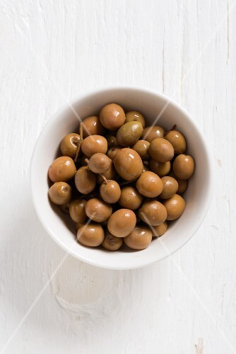 Spanish Albequina olives in a white bowl