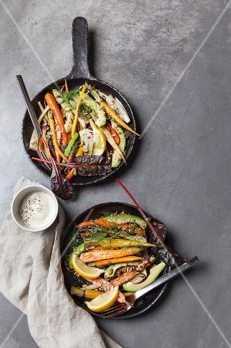 Roasted baby carrots and fennel bulbs with avocado, seeds and tahini yoghurt