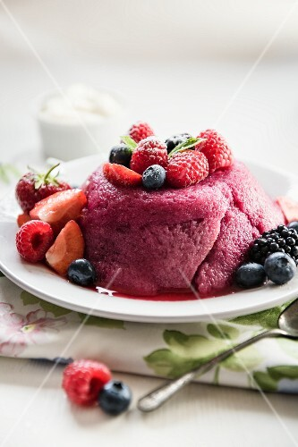 Summer pudding on a plate with fresh berries