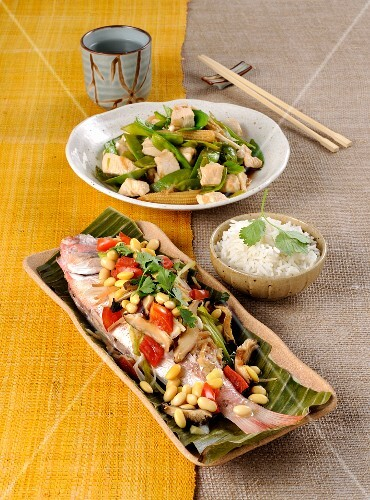 Steamed pandora in a banana leaf, and stir-fried chicken with vegetables