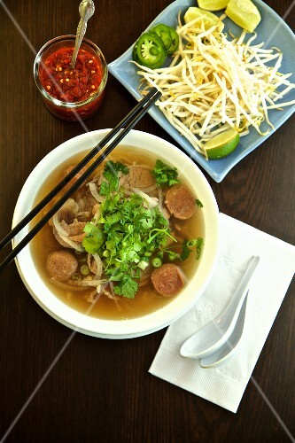 Pho Dac Biet (new soup, Vietnam's) with beef, rice noodles, bean sprouts, limes and basil