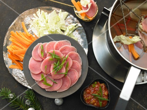 Oriental fondue with pork fillet