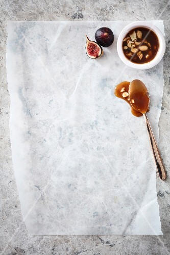 Salted caramel sauce with peanuts and fresh figs