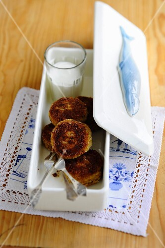 Herring fritters in a porcelain container
