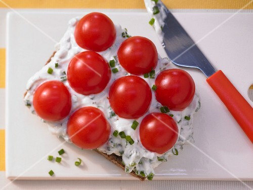 Seeded wholemeal bread topped with herb quark and cherry tomatoes
