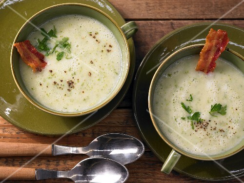 Potato and frisee lettuce soup with crispy bacon