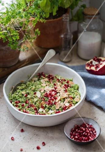 Broccoli salad with pomegranate seeds and almonds
