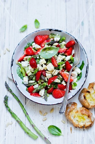 Strawberry and asparagus salad with feta cheese and pine nuts