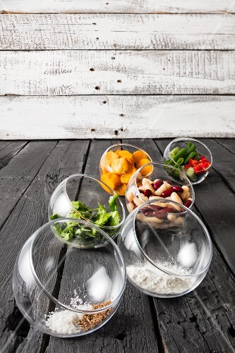 Ingredients for gluten-free veggie burgers in glass bowls