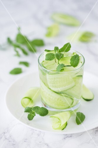 Water with cucumber strips, fresh mint and ice cubes