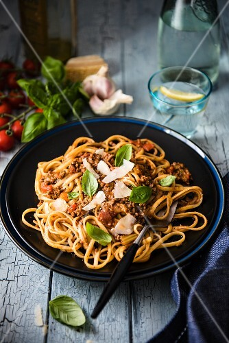Spaghetti Bolognese with Parmesan cheese and fresh basil