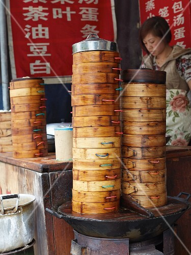 Stacks of bamboo steamers for dim sum at a market (Asia)