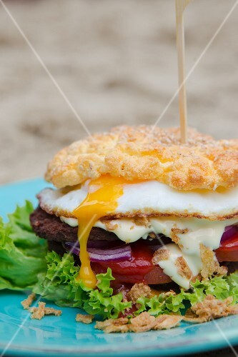 Cloud bread burger with a runny fried egg and roasted onions