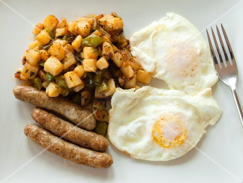 Fried eggs with sausages and fried potatoes