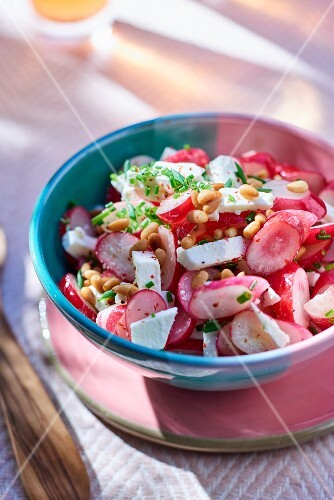 Radish salad with feta cheese and pine nuts