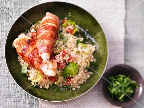 Chicken breast wrapped in bacon on Brussels sprouts couscous