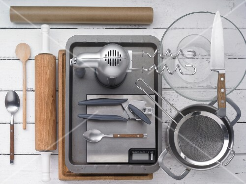 Various kitchen utensils for making pizza