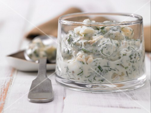 Homemade remoulade with egg, onions and herbs