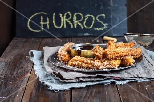Churros with chocolate sauce (Spain)