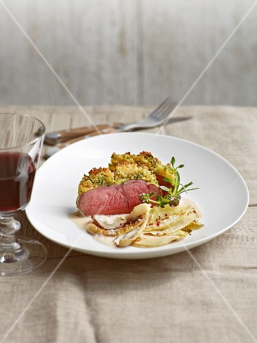 Leg of venison with a herb crust served with oyster mushrooms and fennel