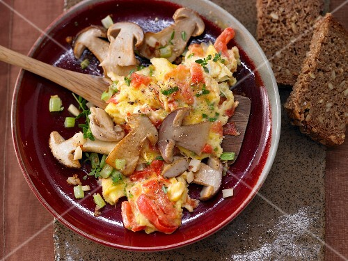 Fried porcini mushrooms with tomato scrambled eggs