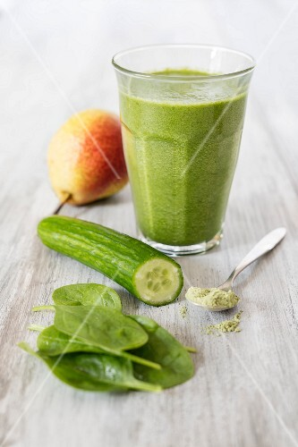 A green smoothie with cucumber, spinach, pear and wheatgrass