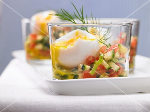 Soft-boiled eggs on a colourful vegetable salad