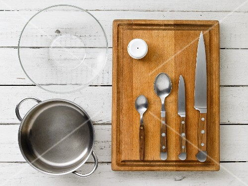Kitchen utensils: a pot, a glass bowl, a egg piercer and cutlery