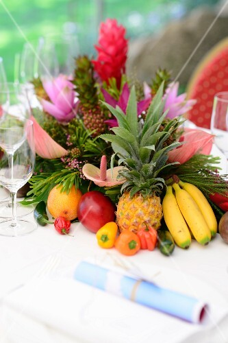Exotic fruit decorations with flowers as table decoration on a Caribbean buffet