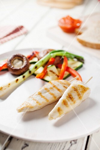 Marinated grilled chicken strips with vegetables
