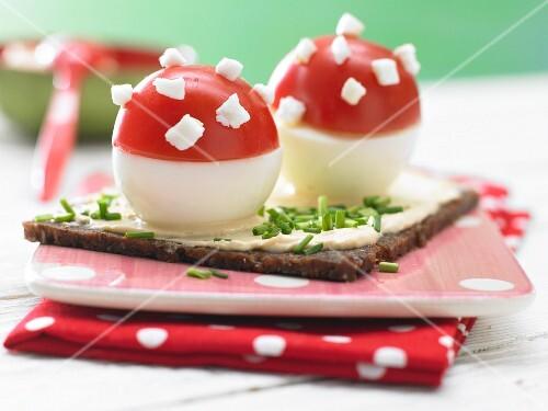 Stuffed tomato toadstools on Pumpernickel bread