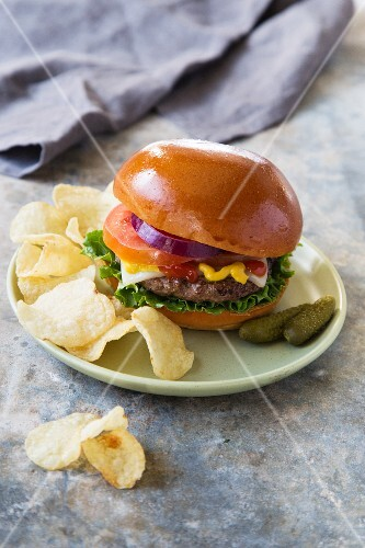 A burger with potato crisps