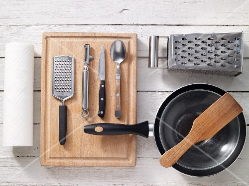 Assorted kitchen utensils for preparing fritters