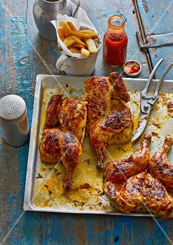 American BBQ butterfly chicken with chips and ketchup