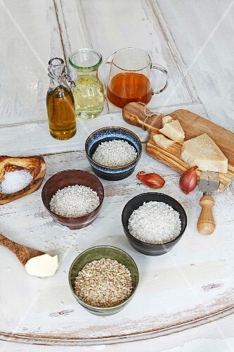 Assorted varieties of risotto rice in bowls with ingredients