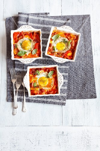 Oven-baked eggs with vegetables and sausage