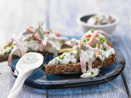 Meat salad with herbs and yoghurt and mustard sauce on wholemeal bread