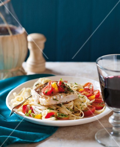 Tagliatelle with Mediterranean vegetables, fish, garlic and tomatoes