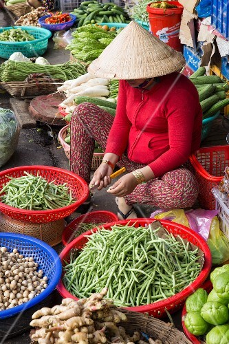A woman selling fresh fruit and vegetables at the market in Can Tho, Vietnam, Asia