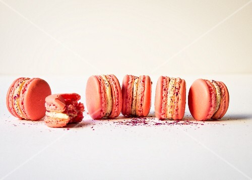 Pink macarons with white ganache and raspberry jam