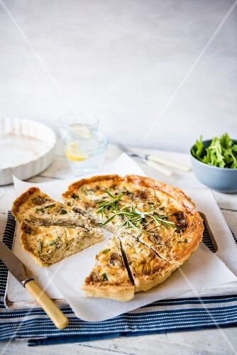 Carmelised onion and blue cheese quiche with rosemary, sliced with one slice removed