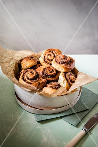 Cinnamon swirls with a pecan nut filling in a wooden box